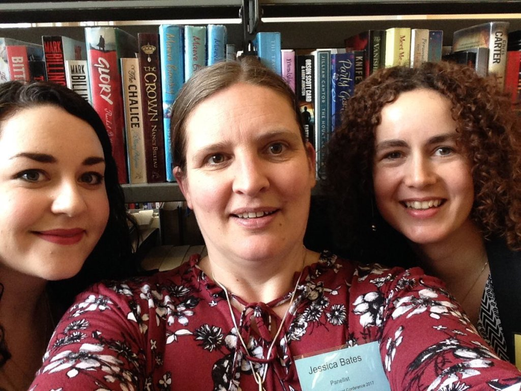 image of Clare Murnane, Jessica Bates and Helena Byrne in front of bookshelves in Pearse Street Library, Dublin