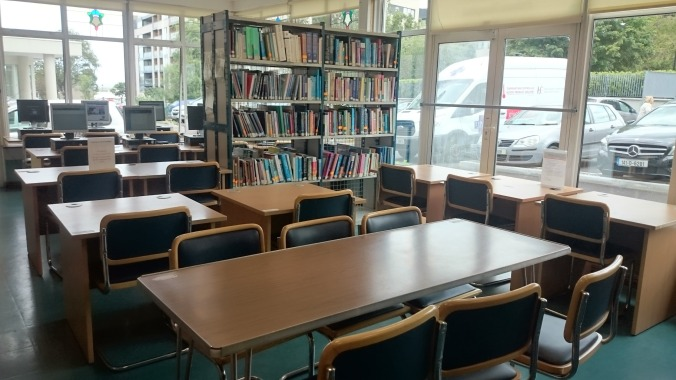 Image of St. Michael's Hospital Library interior, bookcases and desks..